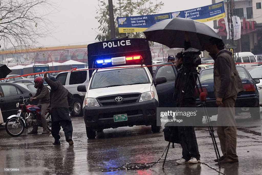 Police arrive at the scene of Pakistan Minority Minister Shahbaz Bhatti's assassination near his mother's home on March 2 2011 in Islamabad Pakistan...
