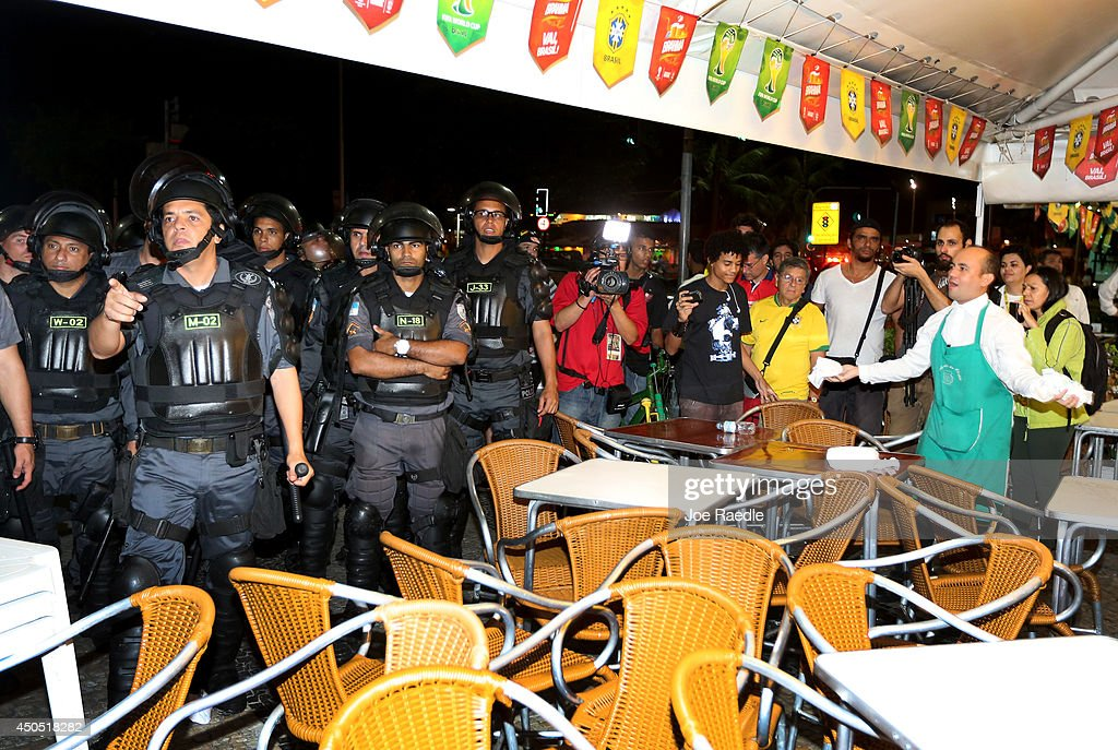 Police arrive where anti-World Cup protestors interrupted people watching the game at a restaurant on Copacabana beach on June 12, 2014 in Rio de Janeiro, Brazil. Brazil defeated Croatia 3-1 in the first match of 2014 FIFA World Cup today.