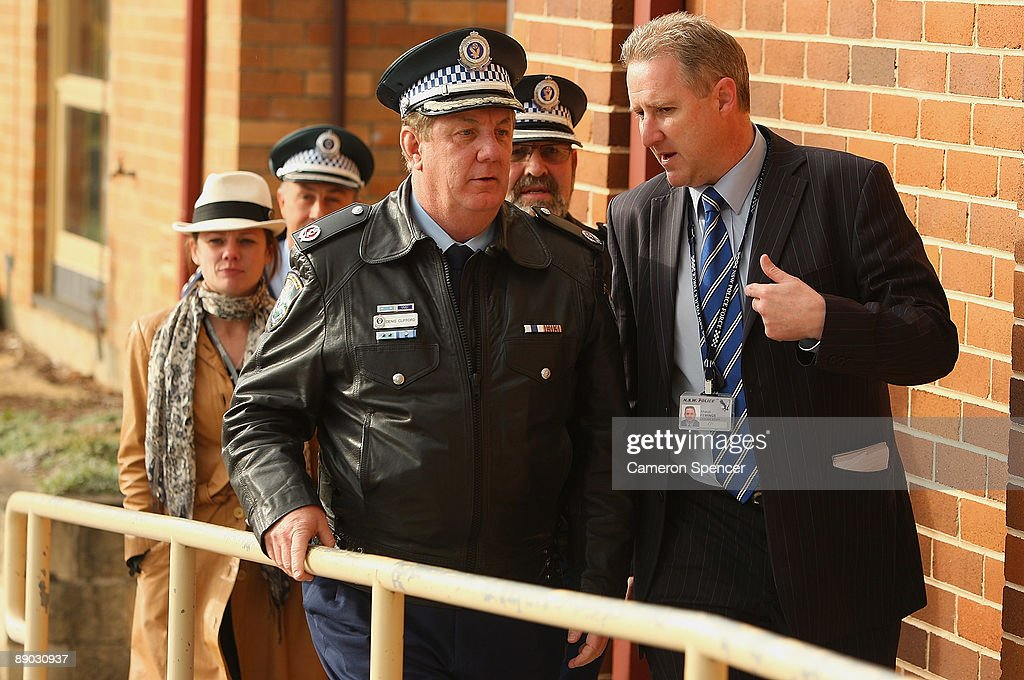 Police Assistant Commisioner Denis Clifford talks to police spokesman Shaun Fewings as they arrive at the Blue Mountains Hospital on July 15, 2009 in Katoomba, Australia. Missing backpacker Jamie Neale was found earlier today after surviving 12 days lost in the bush near Katoomba suffering from only dehydration and exposure.