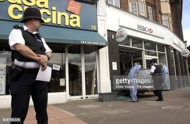 Police at the HSBC bank in Southgate north London after an armed robbery which took place A sixty year old man was injured during the raid as he...