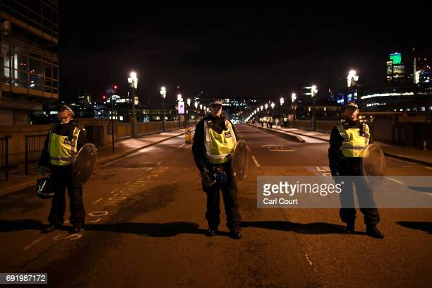 Police at the scene at Southwark Bridge after an attack on London Bridge on June 4 2017 in London England Police have responded to reports of a van...