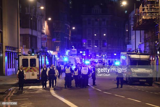 Police at the scene in Borugh high street at London Bridge on June 3 2017 in London England Police have responded to reports of a van hitting...