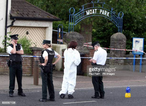 Police at the scene in Moat Park on the Newtownards road in Belfast near to where a man's body was discovered today in a stream in the Dundonald area...