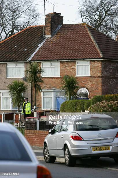 Police at the scene in Redington Road Woolton Liverpool where the bodies of a man and woman believed to be in their late 50s or early 60s were found...