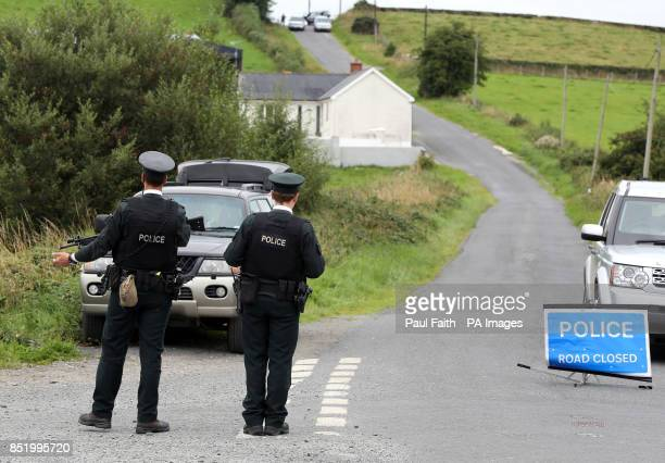 Police at the scene near the village of Cullyhanna Northern Ireland where a dissident republicanstyle rocket launcher has been discovered