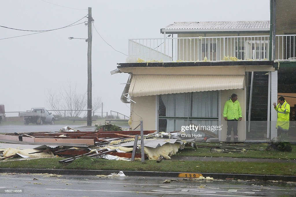 Police at the scene of a roof collapse in Tugun as Queensland experiences severe rains and flooding from Tropical Cyclone Oswald on January 28, 2013 in Gold Coast, Australia. Hundreds have been evacuated from the towns of Gladstone and Bunderberg while the rest of Queensland braces for more flooding.