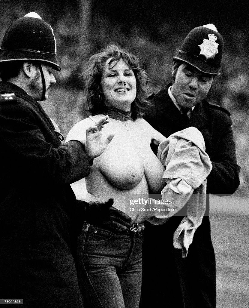 Police at Twickenham Stadium, London, arrest streaker Erica Roe after she ran onto the pitch topless at half time during an England Vs Australia rugby Test match, 2nd January 1982,