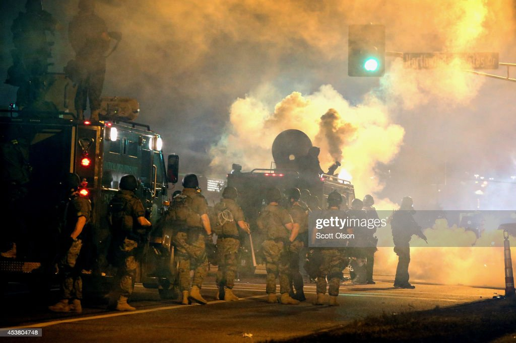 Police attempt to control demonstrators protesting the killing of teenager Michael Brown on August 18, 2014 in Ferguson, Missouri. Police shot smoke and tear gas to disperse the protestors with as they became unruly. Brown was shot and killed by a Ferguson police officer on August 9. Despite the Brown family's continued call for peaceful demonstrations, violent protests have erupted nearly every night in Ferguson since his death.