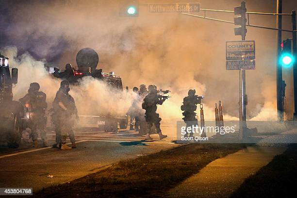 Police attempt to control demonstrators protesting the killing of teenager Michael Brown on August 18 2014 in Ferguson Missouri Police shot smoke and...