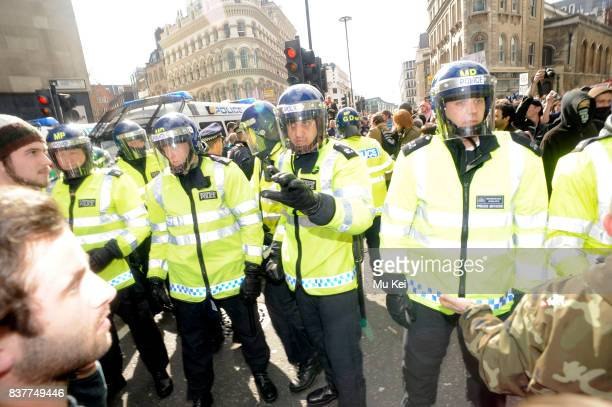 Police attempt to control protesters in the city of London who reject The Meeting of G20 Summit
