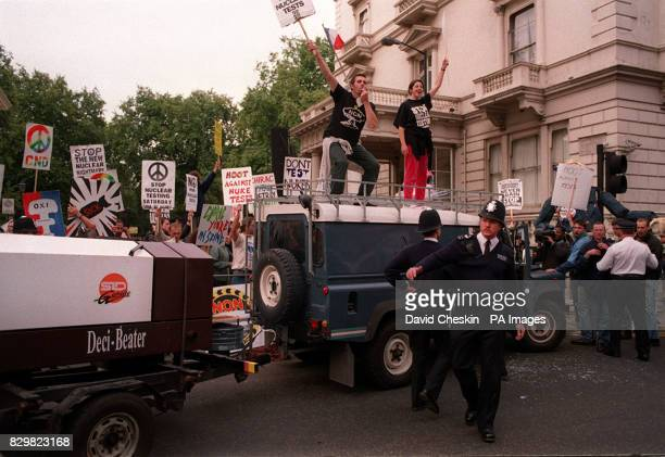 Police attempt to move protesters from outside the French Embassy in London today where demonstrators had gathered to voice opposition to France's...