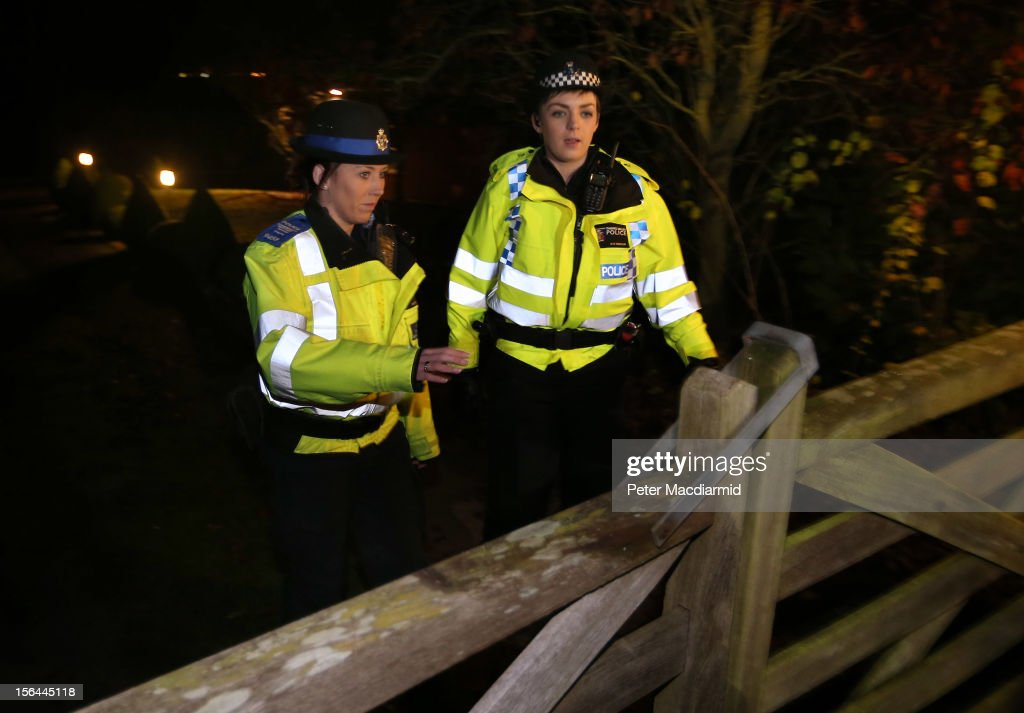 Police attend a house belonging to broadcaster Dave Lee Travis on November 15, 2012 near Leighton Buzzard, England. Police say that they have arrested a man in his 60s as part of an investigation into allegations of sexual abuse by broadcaster Jimmy Savile.