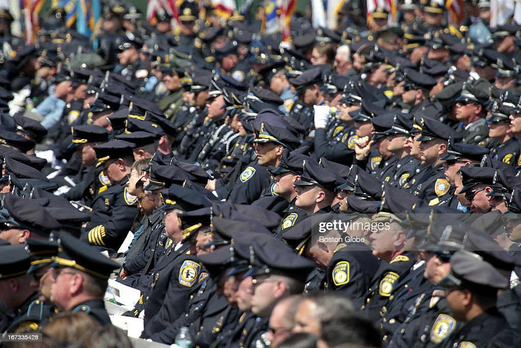 Police attend the memorial service for MIT police officer Sean Collier, at Briggs Field, on the MIT campus. Collier was killed during a shootout with the Boston Marathon bombing suspects.