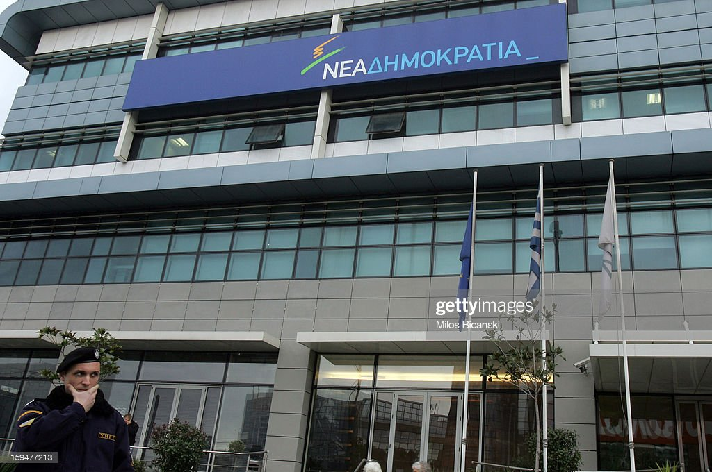 Police attend the scene after an unknown attacker fired an automatic rifle at the offices of the Ruling Party on January 14, 2013 in Athens, Greece. Nobody was injured in the attack which targeted the headquarters of the governing New Democracy party.