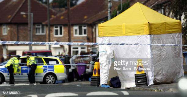 Police attend the scene in the Norris Green area of Liverpool after a man was shot dead