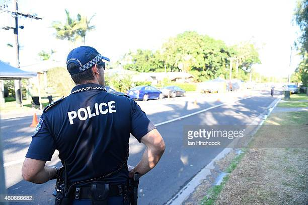 Police attend the scene of a multiple stabbing in the suburb of Manoora on December 19 2014 in Cairns Australia Eight children have been found dead...