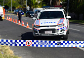 Police attend the scene of a mutliple stabbing in the suburb of Manoora on December 19 2014 in Cairns Australia Eight children have been found dead...