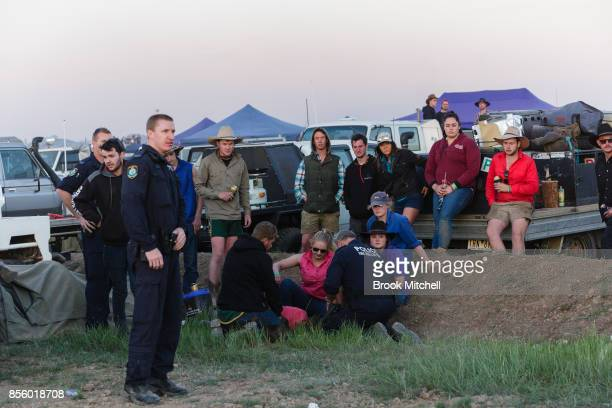 Police attend the scene of an accident where a woman fell from the back of a ute at the 2017 Deni Ute Muster on September 30 2017 in Deniliquin...