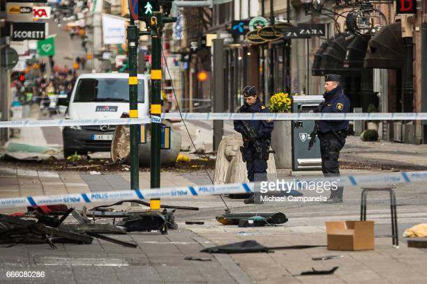 Police attend the scene of the terrorist attack where a truck crashed after driving down a pedestrian street in downtown Stockholm on April 8 2017 in...