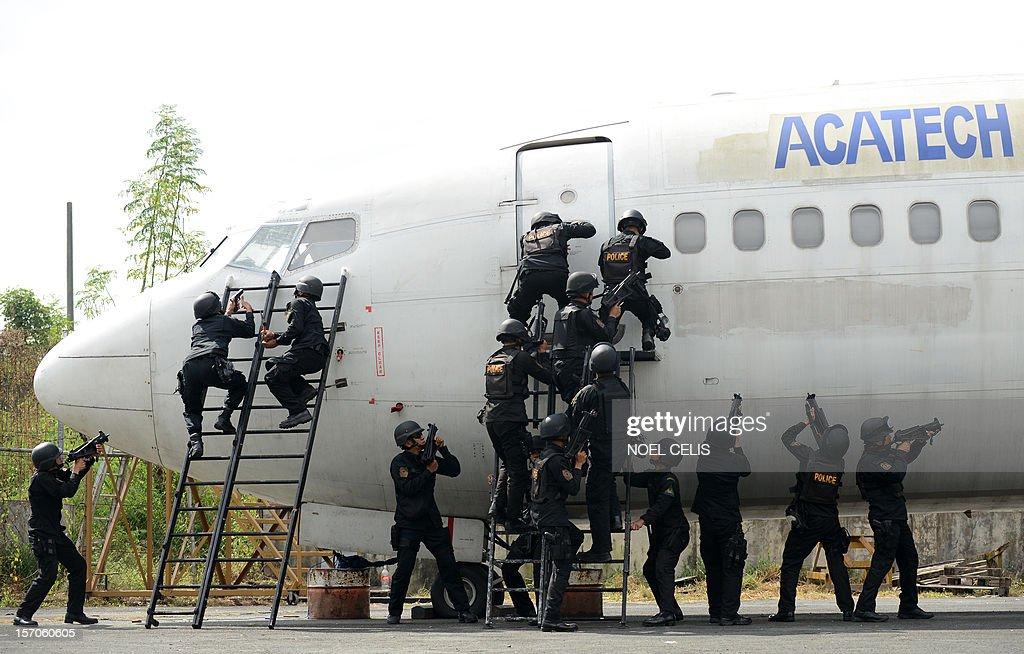 Police Aviation participate in the Philippine National Police (PNP) capability demonstration at the Manila International Airport in Manila on November 28, 2012. The drill is part of the security plan in anticipation of a possible rise in crimes during the coming Christmas season. The Philippines has the longest Christmas season in the world, which officially begins with nine pre-dawn masses nine days before December 25 and typically extends to the first week of January. AFP PHOTO/NOEL CELIS