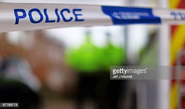 A police banner is displayed outside a house in St Andrews Avenue following a shooting incident on March 17 2010 in Bishopbriggs near Glasgow...