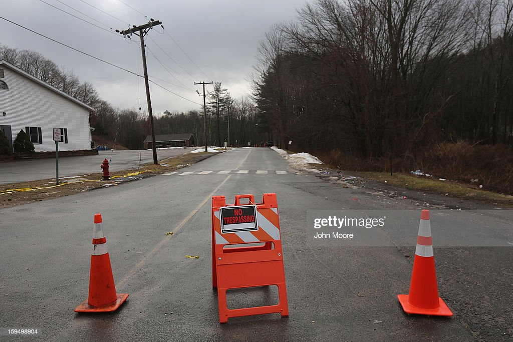A police barricade blocks the road to Sandy Hook Elementary School on January 14, 2013 in Newtown, Connecticut. The town marked a month anniversay since the massacre of 26 children and adults at the school, the second-worst such shooting in U.S. history.
