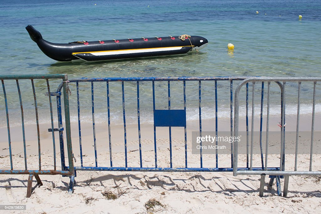 Police barricades are seen on the beach in preparation for a memorial service for victims of the 2015 Sousse beach terrorist attack on June 25, 2016 in Sousse, Tunisia. Before the 2011 revolution, tourism in Tunisia accounted for approximately 7% of the countries GDP. The two 2015 terrorist attacks at the Bardo Museum and Sousse Beach saw tourism numbers plummet even further forcing hotels to close and many tourism and hospitality workers to lose their jobs. The 26th of June marks the anniversary of the Sousse beach attacks.
