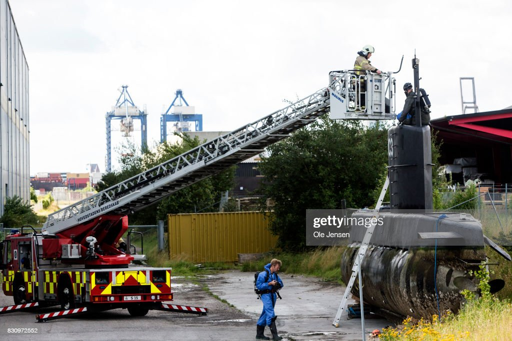 Police begin their forensic investigation work on the privately owned submarine, Nautilus, which is the suspected crime scene for the assumed murder on Swedish journalist Kim Wall on August 13, 2017 in Copenhagen, Denmark. The submarine sailed out of Copenhagen harbor Thursday evening with owner Peter Madsen and Kim Wall onboard. Later the submarine sank in 8 meters water. Peter Madsen was safely rescued but the Swedish journalist was missing and Madsen was subsequently arrested by the police and charged for murder. Madsen claimed that the woman was put ashore before the submarine sank. Madsen appeared for a preliminary examination at the Copenhagen Court Saturday afternoon. Police are now to investigate the submarine, which is built by Madsen himself. The Swedish journalist is still being searched for by the police. Her identity was released Saturday by her family to Danish broadcaster TV2.