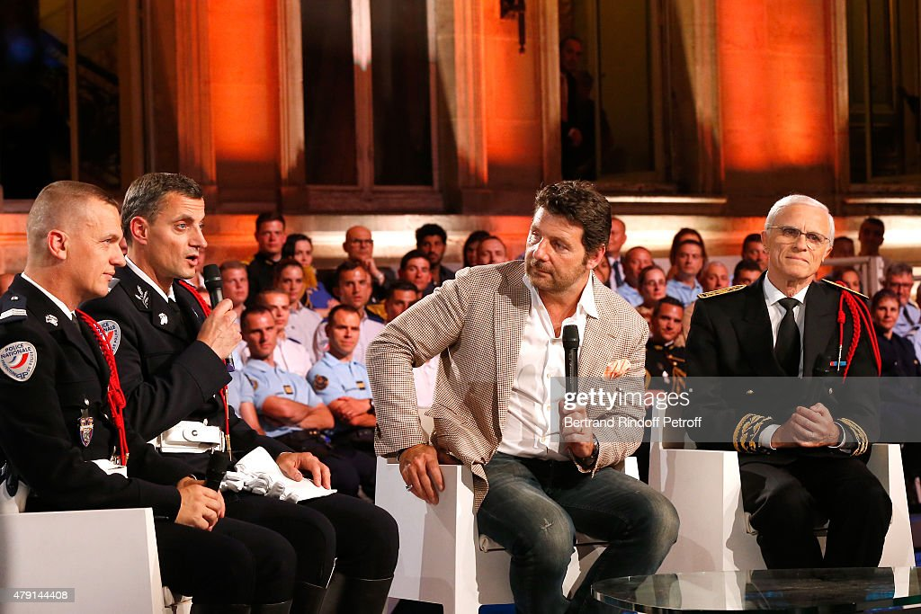 Police Biker Ulrich Crucq, Alexandre Fouchard, Actor Philippe Lellouche and Paris Police Prefect <a gi-track='captionPersonalityLinkClicked' href=/galleries/search?phrase=Bernard+Boucault&family=editorial&specificpeople=7772884 ng-click='$event.stopPropagation()'>Bernard Boucault</a> attend the 'Une Nuit avec la Police et la Gendarmerie' : France 2 TV Show. Held at Ministere de l'Interieur in Paris on June 30, 2015 in Paris, France.
