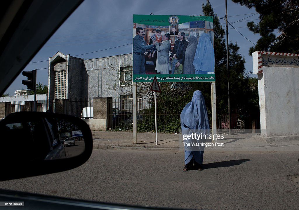 A police billboard picture proclaims, 'The rescue and handover of Sayed Arshad, a two and a half yr-old baby from the claws of kidnappers to his family,' off Walayat Street downtown on April 11, 2013 in Herat, Afghanistan. Herat's relative success economically have caused hundreds of kidnappings, with families of businessmen paying large sums to ransom their relatives.