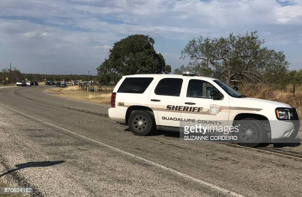Police block a road in Sutherland Springs Texas on November 5 after a mass shooting a church nearby A gunman shot dead at least 20 worshippers...