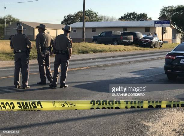 TOPSHOT Police block a road in Sutherland Springs Texas on November 5 after a mass shooting at the the First Baptist Church A gunman went into the...