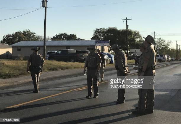 Police block a road in Sutherland Springs Texas on November 5 after a mass shooting at the the First Baptist Church A gunman went into the church...