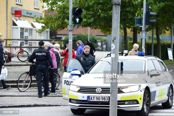 Police block a road to ROs Torv shopping centre in Roskilde Denmark on October 17 2016 The airport in Roskilde and two shopping centers were...