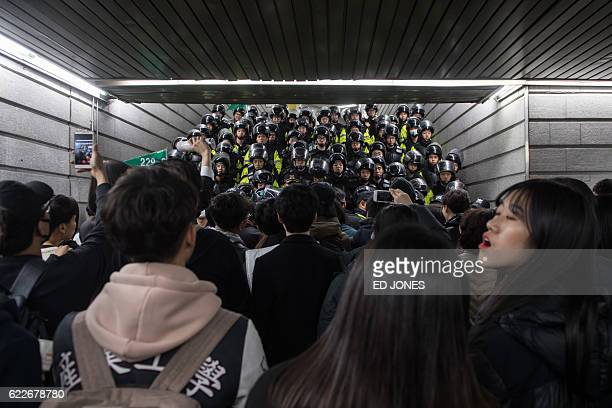 TOPSHOT Police block a subway exit during antigovernment protest in central Seoul on November 12 2016 Up to one million people were expected to take...