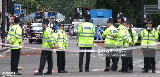 Police block access to a doubledeck bus that was destroyed after a terrorist bomb exploded on it near Tavistock Square in London 07 July 2005...