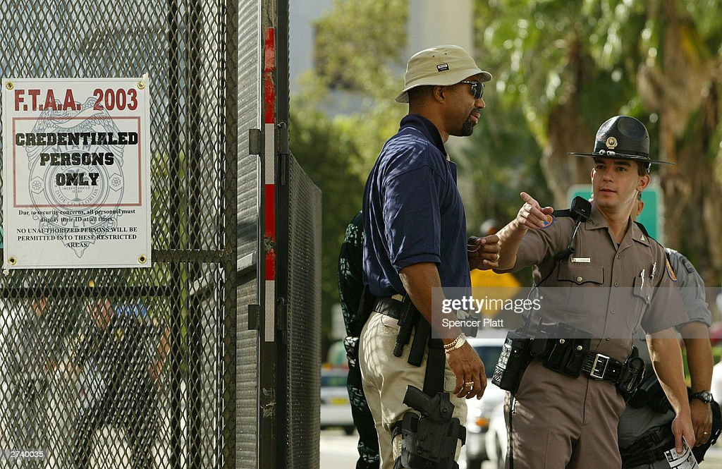 Police block an entrance on the second day of the summit to create a Free Trade Area of the Americas (FTAA) being held November 18, 2003 in downtown in Miami, Florida. Due to expected protests from anarchists, labor groups and globalization foes, much of the city of Miami is in a police lockdown, with thousands of businesses closed and a steel barricade circling the summit area.