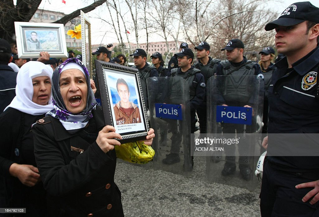 Police block family members of 34 Turkish Kurdish civilians, who were killed in December 2011 in Uludere at the Turkey-Iraq border by Turkish military jets that mistook the group for Kurdish rebels based in Iraq, on March 28, 2013 during a protest outside the Turkish Parliament in Ankara. A recent parliamentary report on the massacre concluded that the Turkish military's air strike was not deliberate.