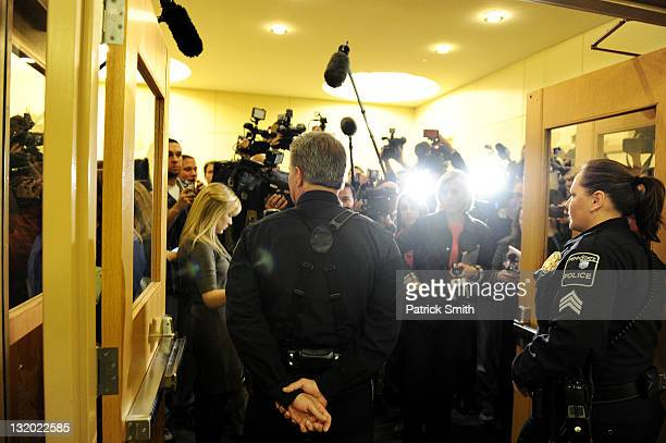 Police block media before the announcement that Penn State president Graham Spanier and football head coach Joe Paterno have been fired during the...