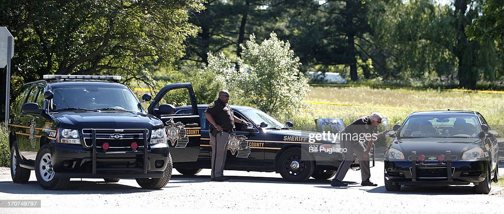 Police block off a road where FBI agents are searching a field for the alleged remains of former Teamsters' union president Jimmy Hoffa June 17, 2013 in Oakland Township, Michigan. The agents were acting on a tip provided by Tony Zerilli, 85, a former mobster, who was released from prison in 2008. Hoffa, who had reported ties to organized crime, went missing in July of 1975.