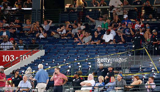 Police block off a section with police tape after a fan fell from the upper deck of Turner Field in the seventh inning during the game between the...