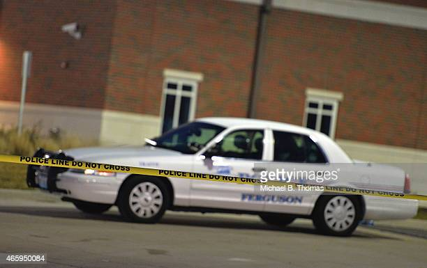 Police block off an area on South Florissant Road outside the Ferguson Police Department on March12 2015 in Ferguson MO Two police officers were shot...