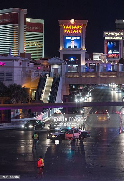 Police block off the road as they and local officials investigate a part of the Las Vegas Strip after a car ran into a group of pedestrians between...