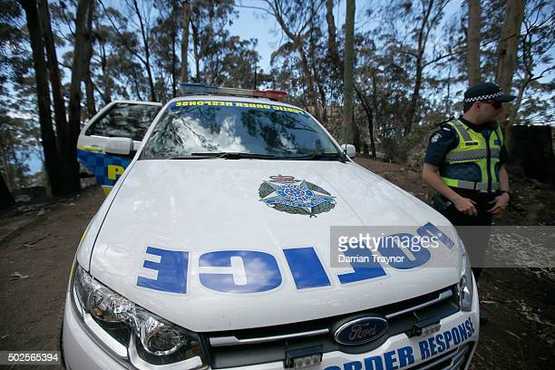 Police block roads in Wye River on December 27 2015 in Melbourne Australia Over 116 homes in the Wye River area along Victoria's Great Ocean Road...