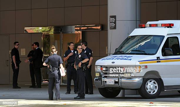 Police block the entrance of the emergency room at the UCLA Medical Center after the reported death of US singer Michael Jackson who was taken to the...