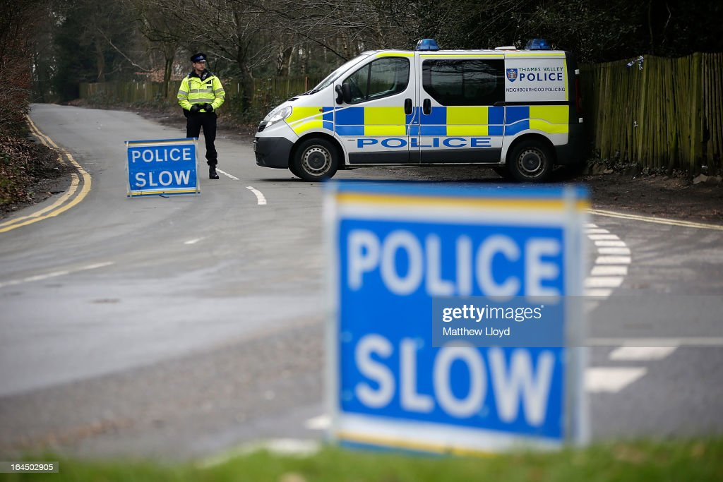 Police block the road leading to the home of Russian oligarch Boris Berezovsky after he was found dead on March 24, 2013 in Sunningdale, England. Specialist police teams skilled in biological, nuclear and chemical materials have been called in to search the property and investigate the cause of death. Berezovsky, aged 67, emigrated to the United Kingdom in 2000 and achieved political asylum three years later on the grounds that his life would be in danger should he return to Russia.