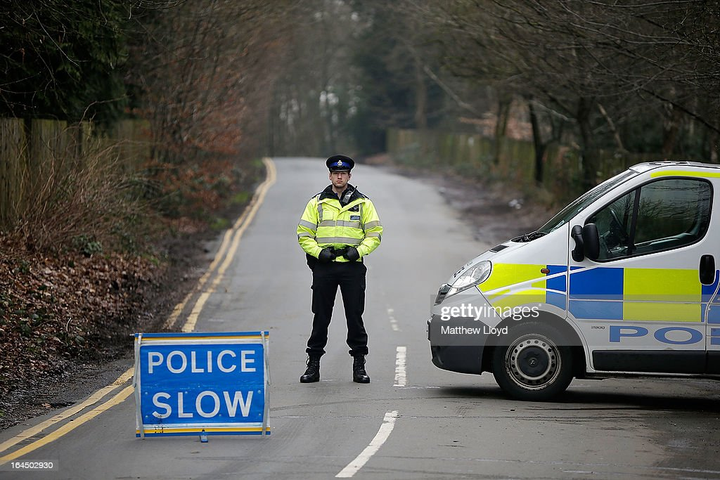 Police block the road leading to the home of Russian oligarch Boris Berezovsky after he was found dead on March 24, 2013 in Sunningdale, England. Specialist police teams skilled in biological, nuclear and chemical materials have been called in to search the property and investigate the cause of death which they have reported as unexplained. Berezovsky, aged 67, emigrated to the United Kingdom in 2000 and achieved political asylum three years later on the grounds that his life would be in danger should he return to Russia.
