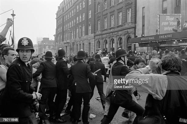 Police blocking off Whitehall as rioting breaks out during a demonstration against the Poll Tax London 31st March 1990