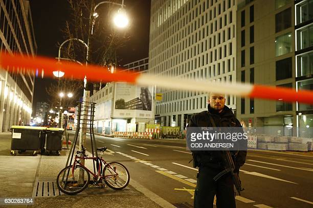 Police blocks a road leading to the site next to the Gedächtniskirche church where a truck crashed into a christmas market in Berlin on December 19...