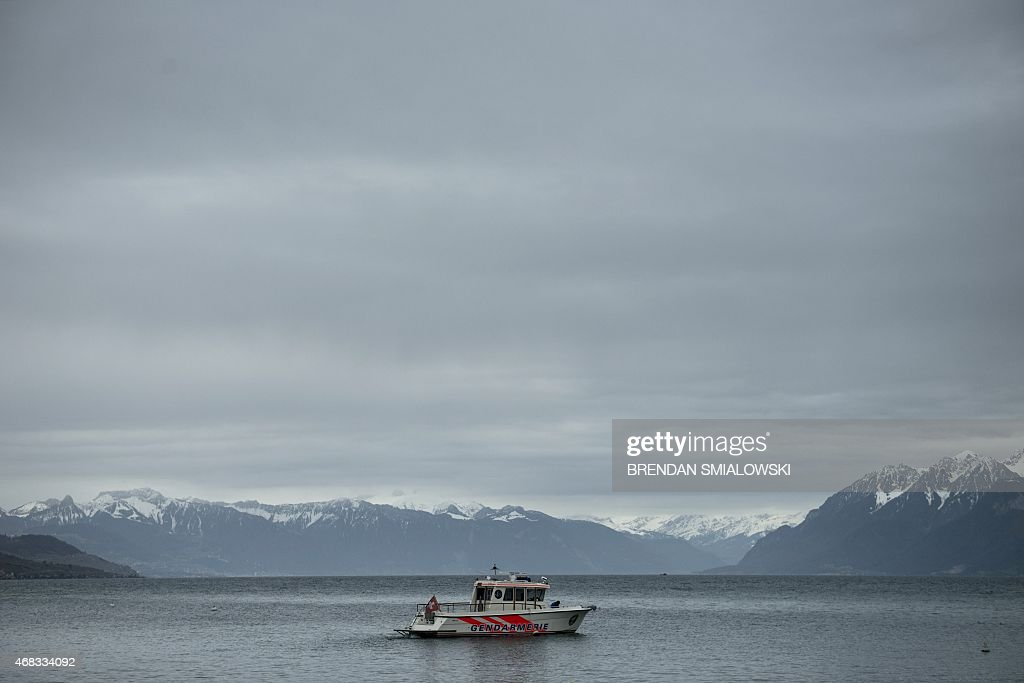 A police boat guards Lake Geneva near the Beau Rivage Palace Hotel during an extended round of nuclear talks on April 2 2015 in Lausanne Switzerland...